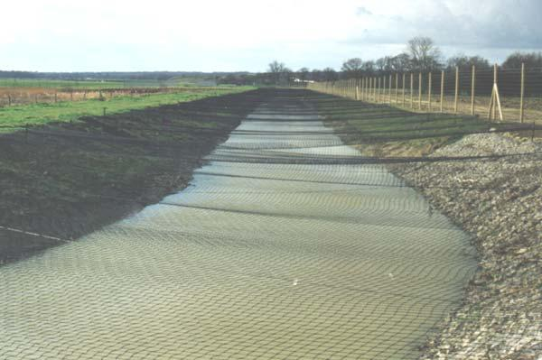 Water retention ponds can be proofed against Birds with netting or, as in this case with floating 'bird balls'